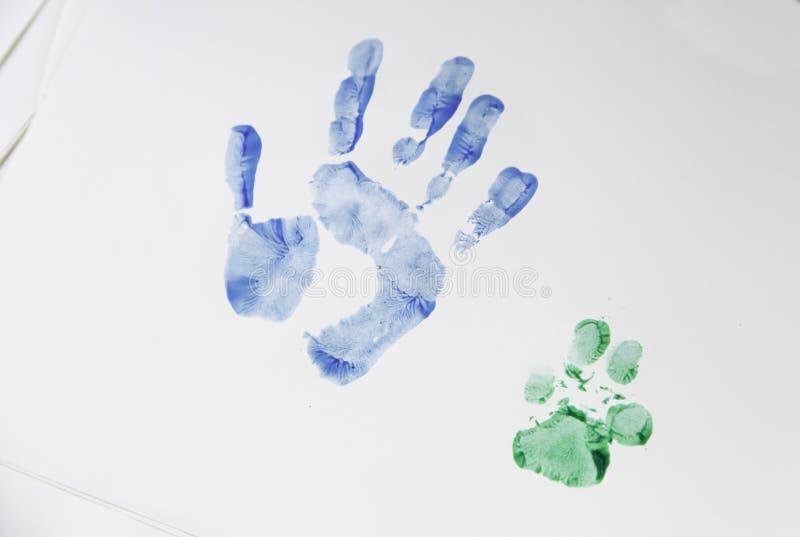 Footprint hand and dog royalty free stock image