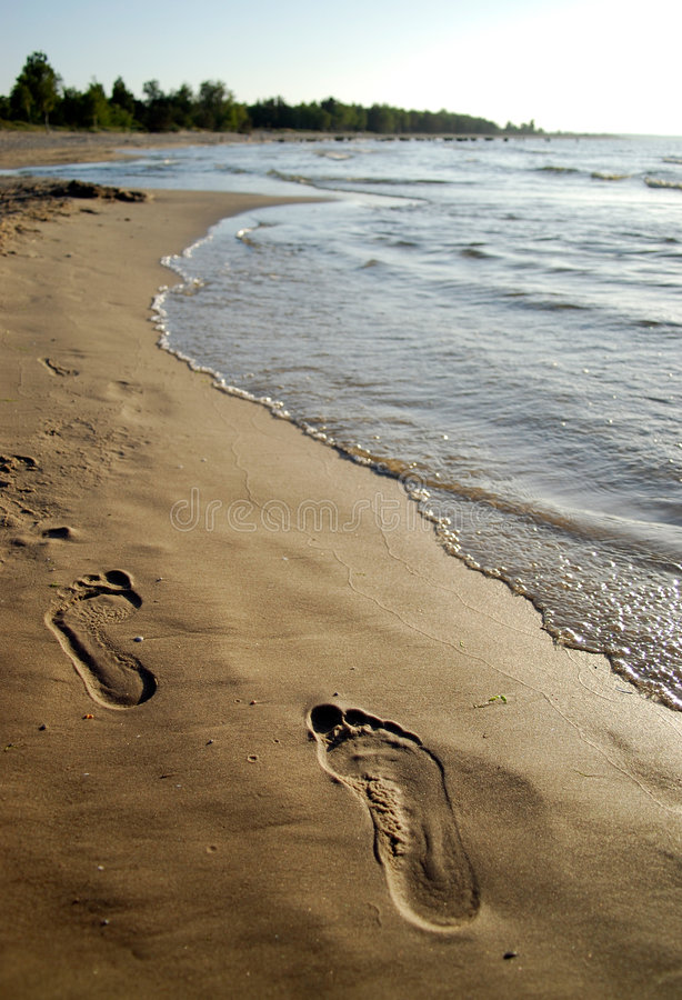Footprint on sand. At sunset stock images