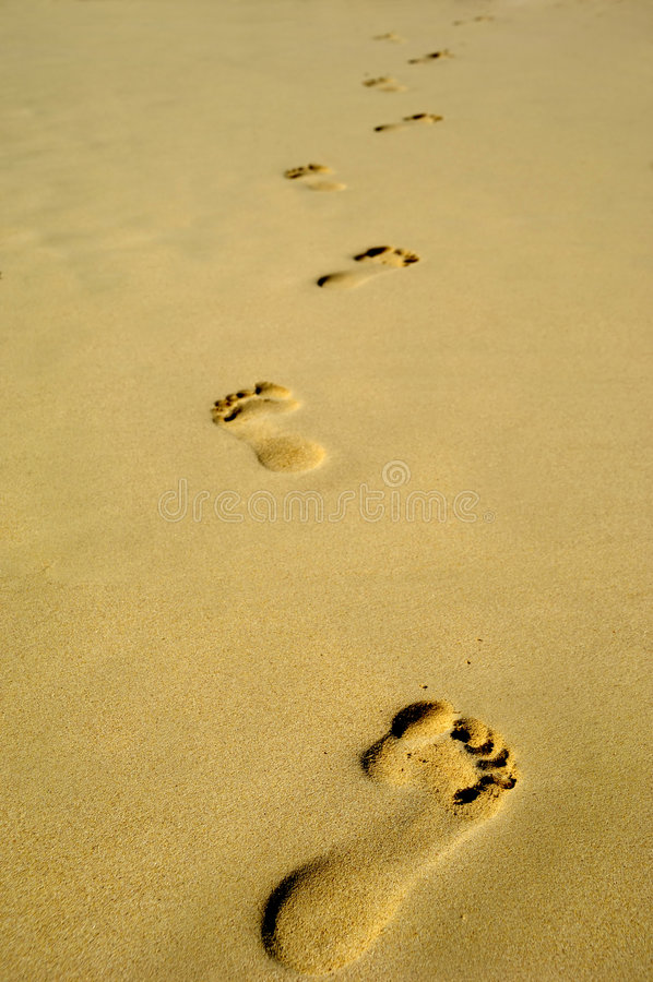 Footprint in sand on beach stock photography