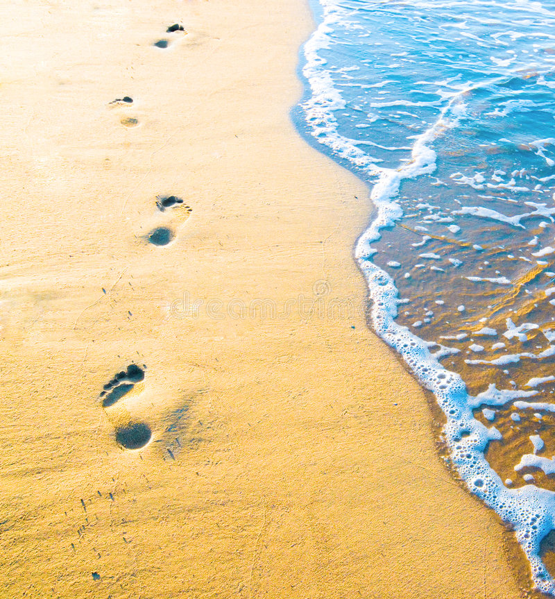 Footprint on sand with foam