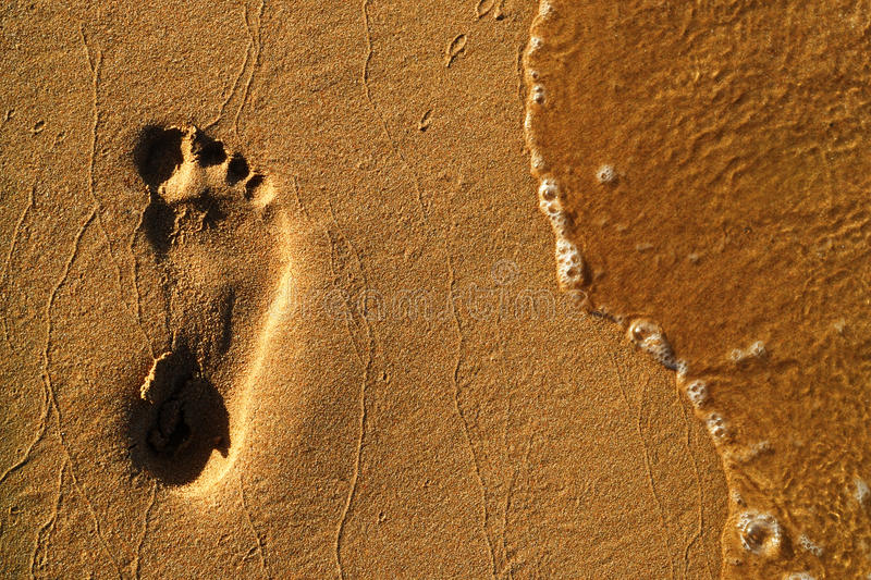 A footprint in the sand stock photography