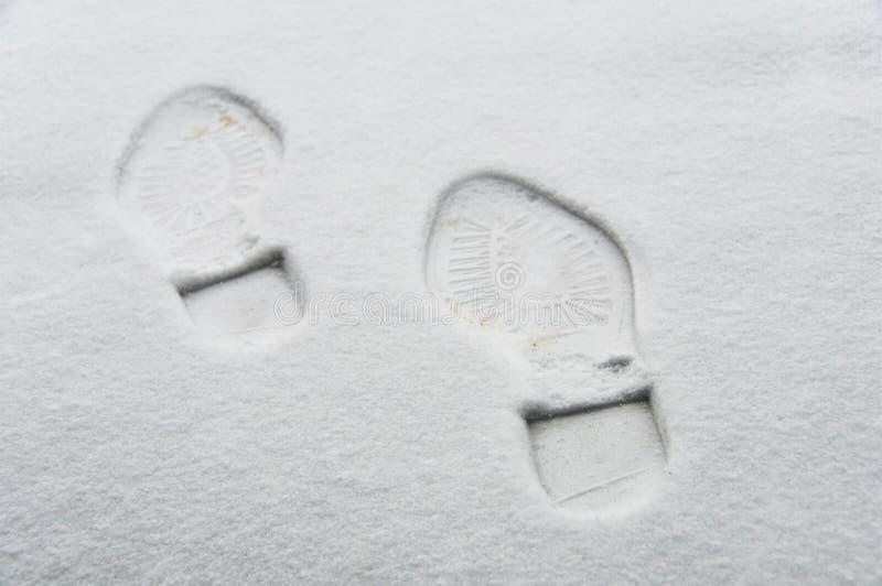 Footprint in the snow stock photos