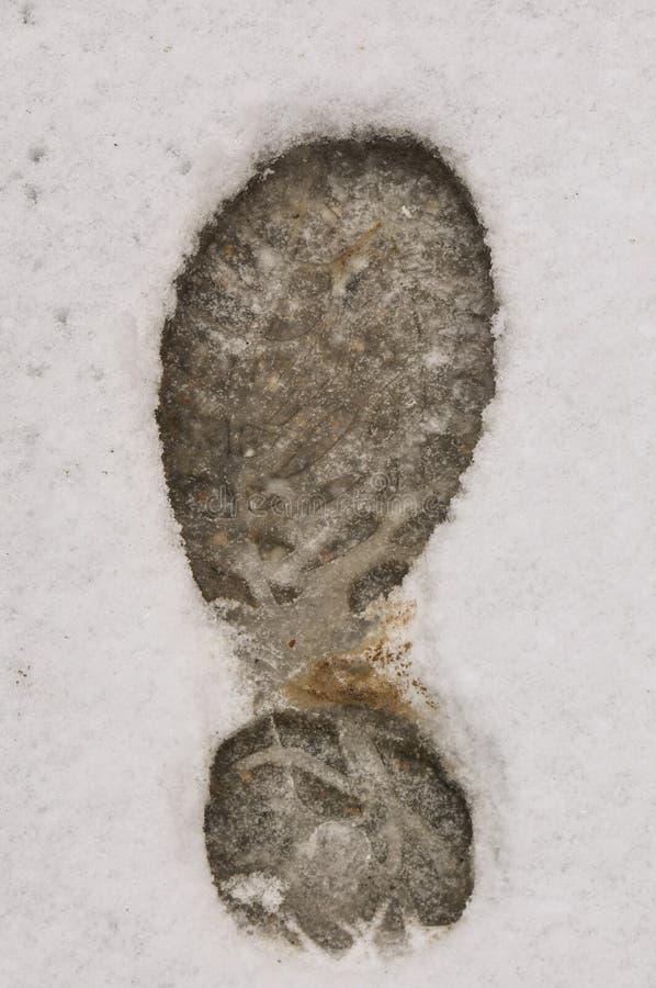 Footprint in snow stock image