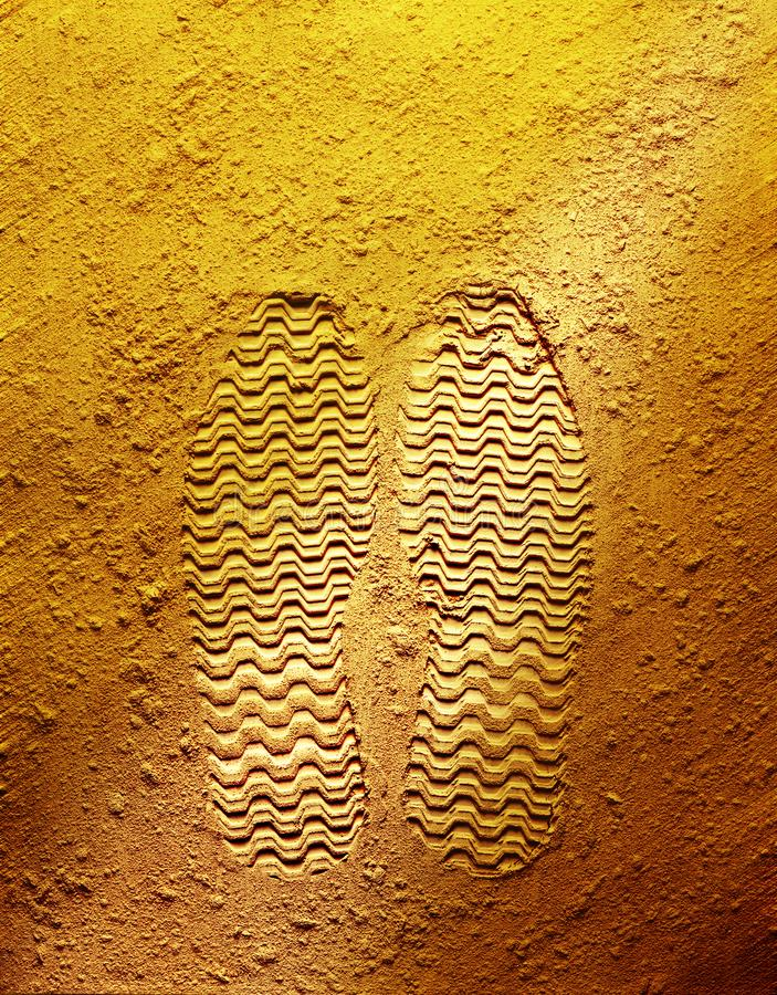 Footprint on yellow background royalty free stock image