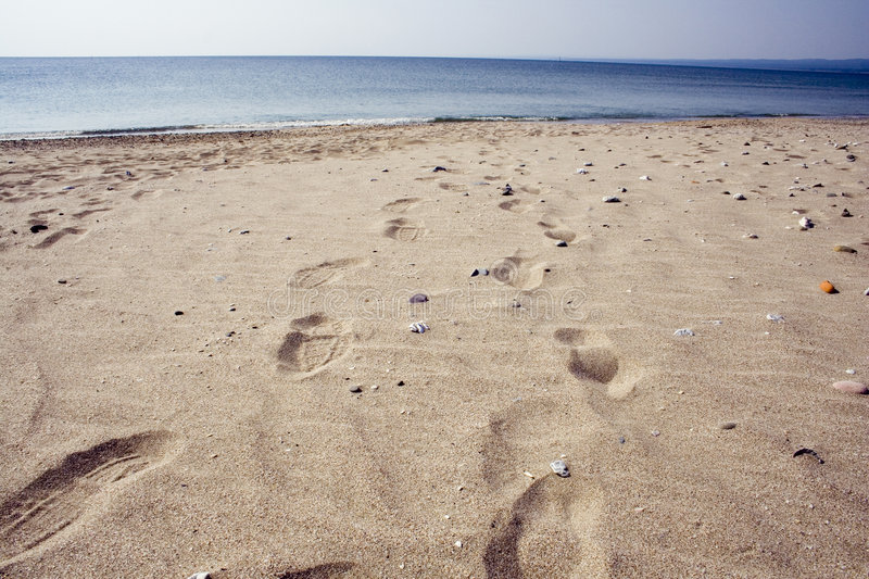 Footprints on a beach. royalty free stock photo