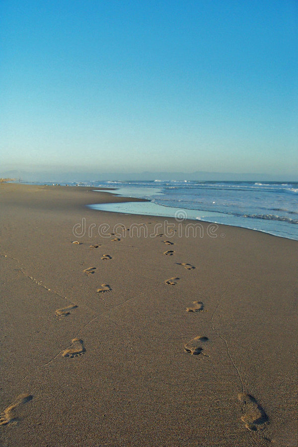 Footprints on beach stock photo