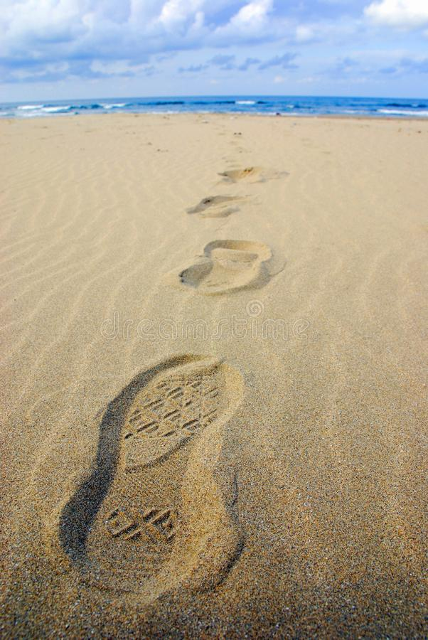 Footprints on the beach royalty free stock image