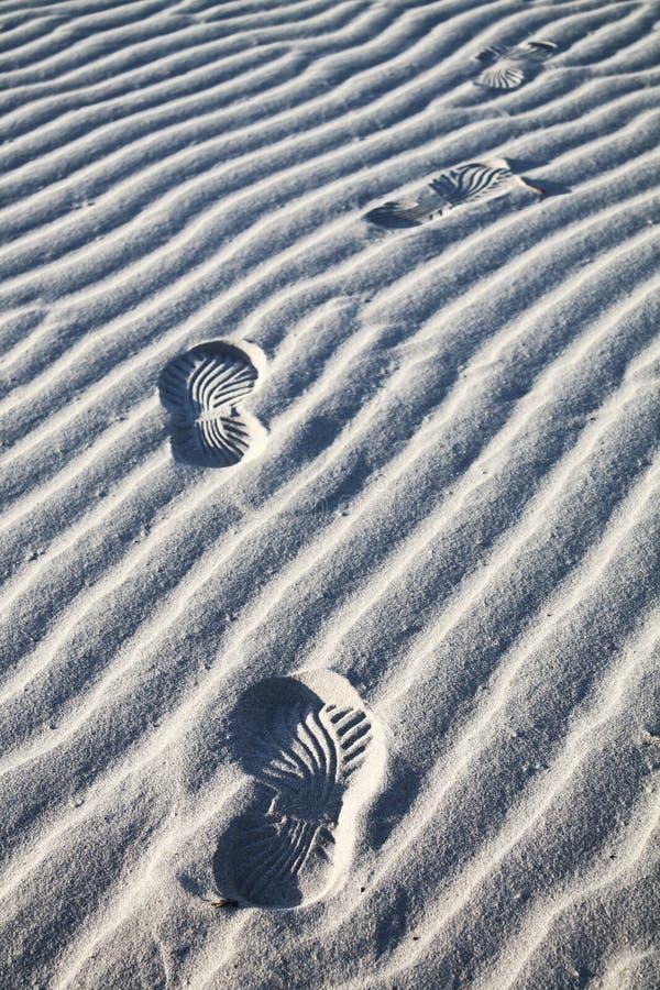 Footprints on Beach sand royalty free stock image
