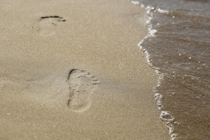 Footprints on the beach. In Zakynthos Island, Greece stock photos
