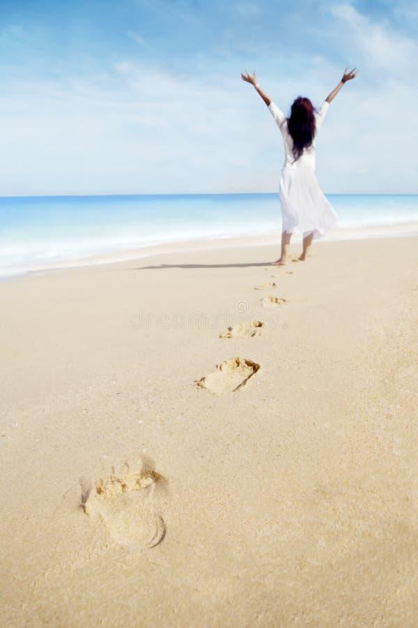 Footprints And Carefree Woman Stock Photos