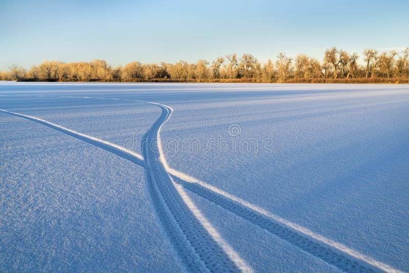 Footprints of a fat tire bike. On a a frozen lake in northern Colorado stock photos