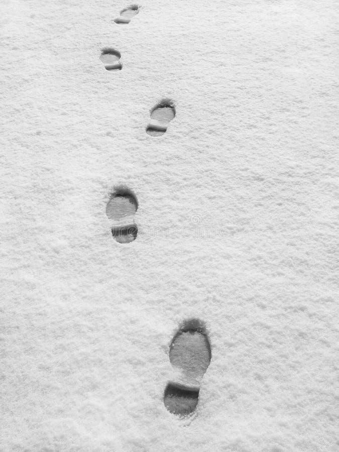Footprints in fresh snow stock photo