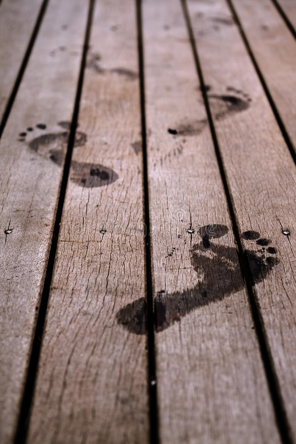 Footprints. Human footprints on wooden surface royalty free stock images