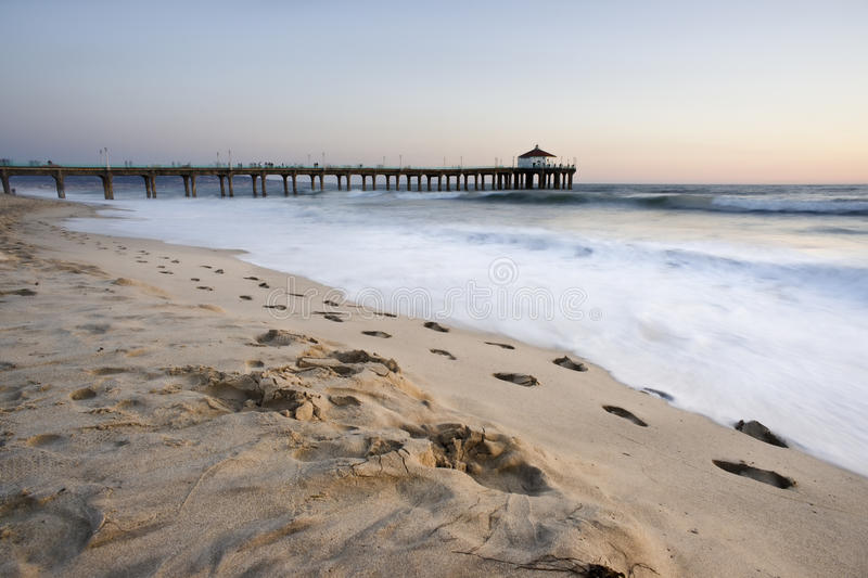 Footprints and the Manhattan Beach Pier royalty free stock images