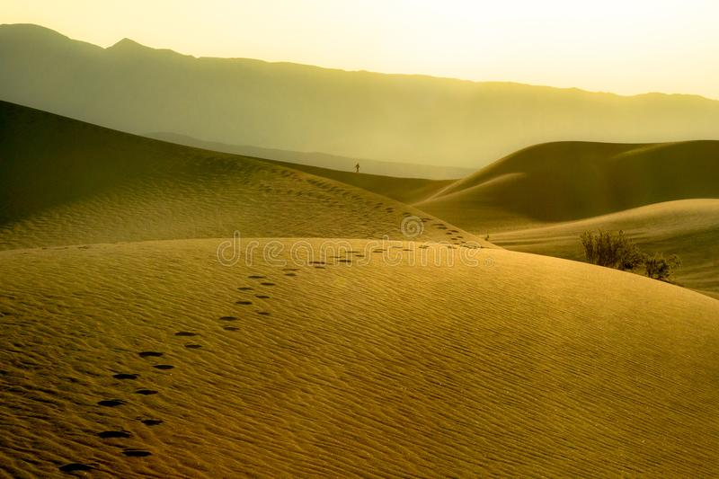 Footprints in desert dunes of Death Valley National park. Landscape image embodying self discover and perseverance. Footprints in the Mesquite Sand Dunes of stock photo