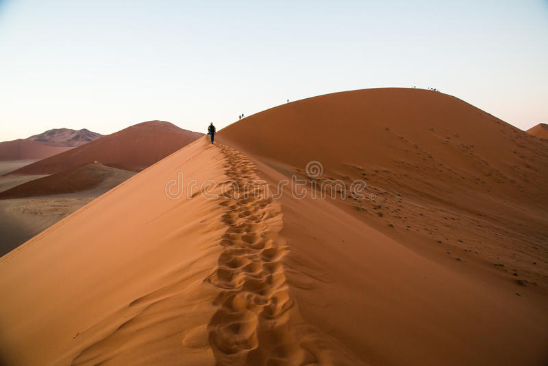 Sossusvlei Dune 45 Namibia. Footprints and people on Dune 45 Sossusvlei stock images