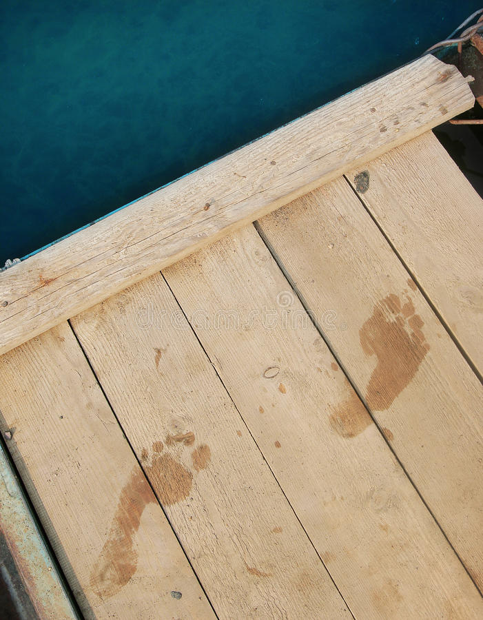 Footprints on the pier royalty free stock images