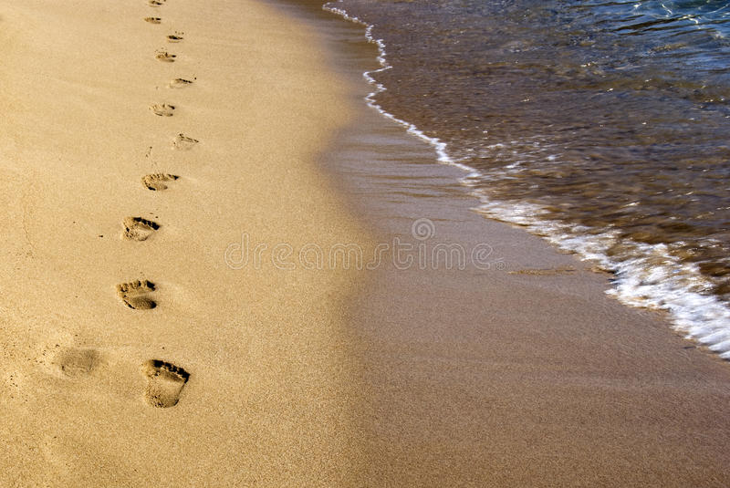 Footprints on the sand royalty free stock image