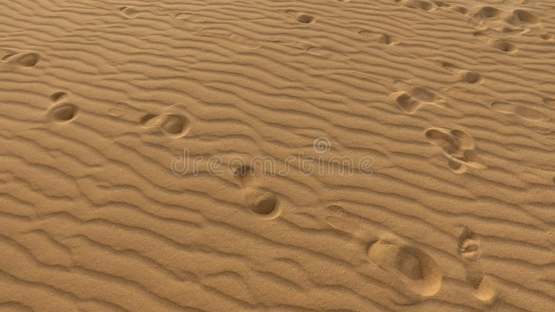 Footprints on sand dune, grains of sand, Corralejo, natural park. Fuerteventura. stock photography