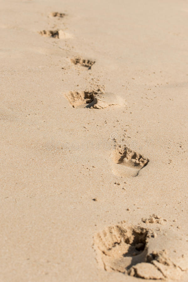 Footprints on the sand stock images