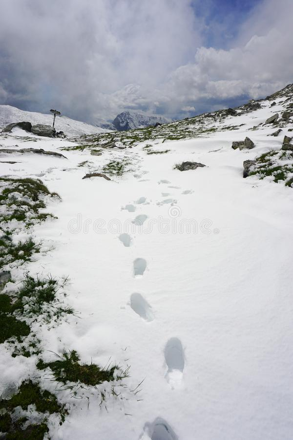 Footprints in snow stock photos