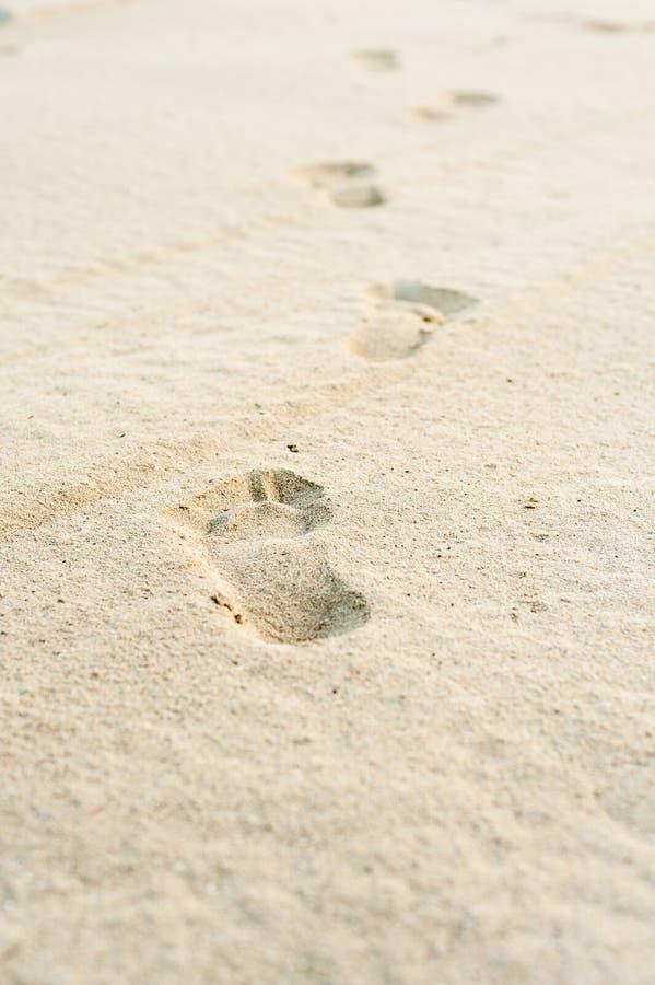 Footprints on white sand royalty free stock photos