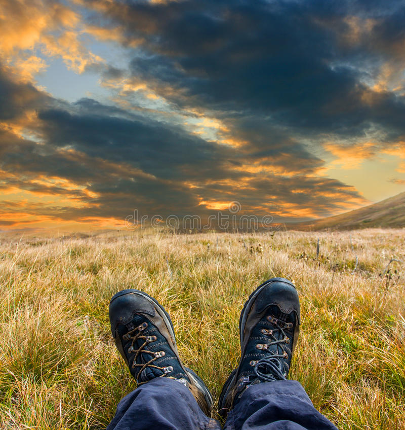 Foots with hikers boots royalty free stock photography