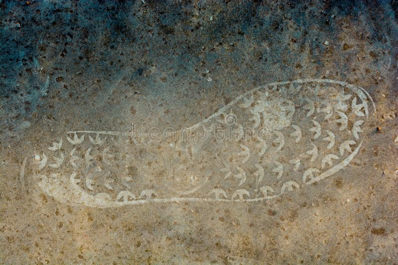 Footstep pattern on as abstract grunge background stock photography