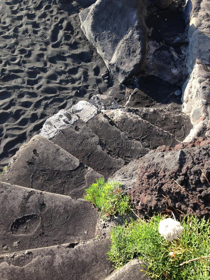 Footsteps on beach of Stromboli stock images
