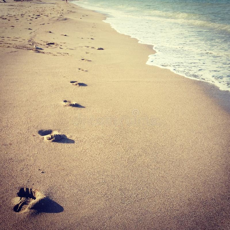 Footsteps at the beach. On a sunny day stock photo