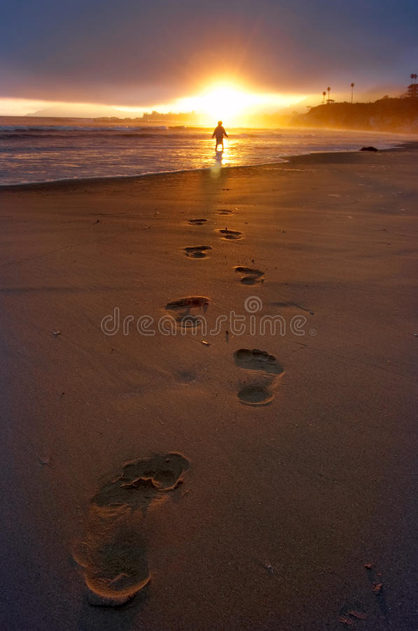 Footsteps in the sand royalty free stock images