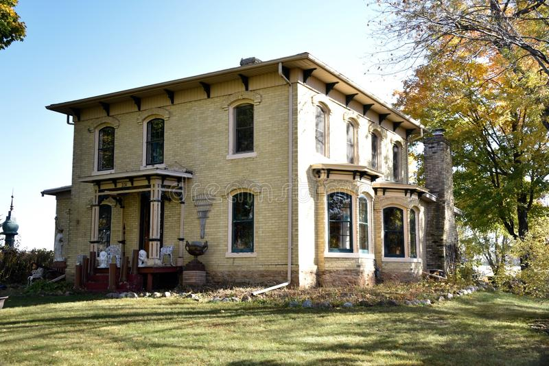 Footville Italianate. This is a Fall picture of the Soloman Strang House located in Footsville, Wisconsin. The house built in 1875 is an example of Victorian stock photography