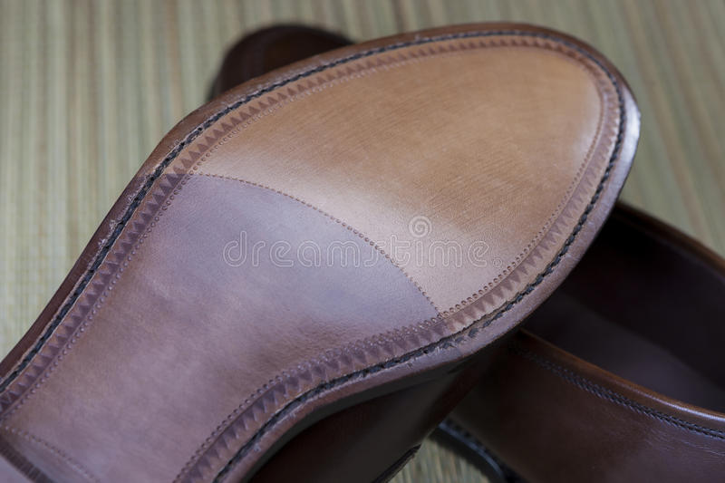 Footwear Concepts. Backside View of Penny Loafer Natural Leather Sole. stock photography