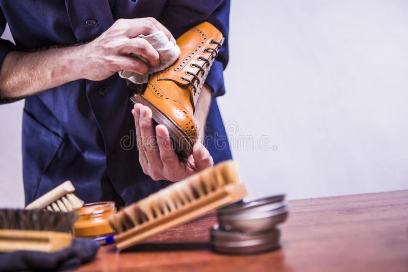 Footwear Concepts. Closeup of Mans Hands with Cleaning Brush stock photos
