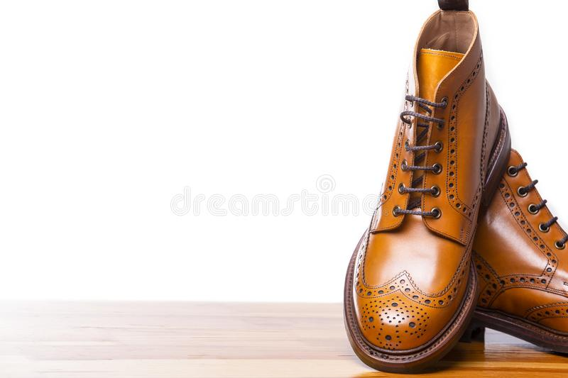 Footwear Concepts.Closeup of Pair of High Gentleman Tanned Brogues. Boots. Isolated Over White Background.Horizontal Image stock image