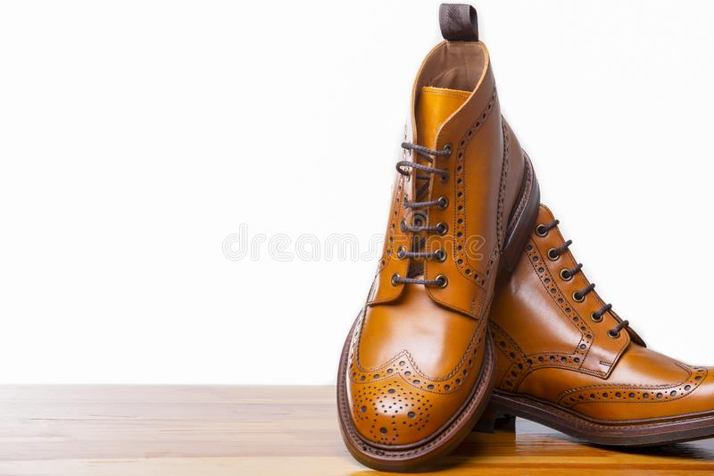 Footwear Concepts.Closeup of Pair of High Gentleman Tanned Brogues. Boots. Isolated Over White Background.Horizontal Image Composition royalty free stock photography