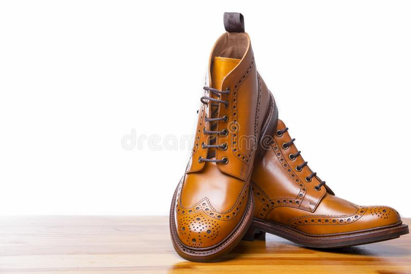 Footwear Concepts.Closeup of Pair of High Men`s Tanned Brogues. Boots. Over White Background.Horizontal Image royalty free stock photography