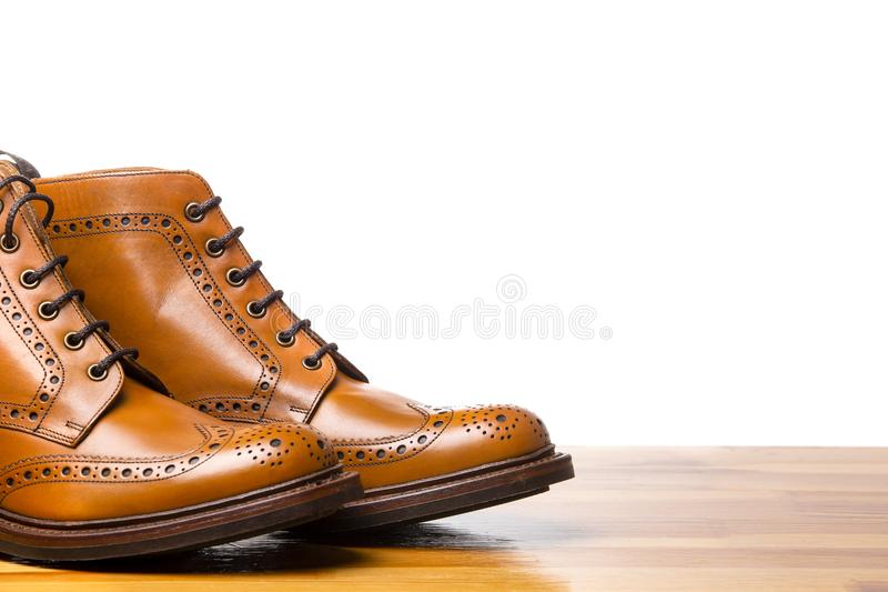 Footwear Concepts.Closeup of Tips of Pair of Tanned Brogues Boots. Isolated Over White Background. Horizontal Image composition stock image