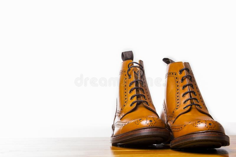 Footwear Concepts.Pair of High Gentleman Tanned Brogues Boots. Isolated Over White Background.Horizontal Shot royalty free stock photos