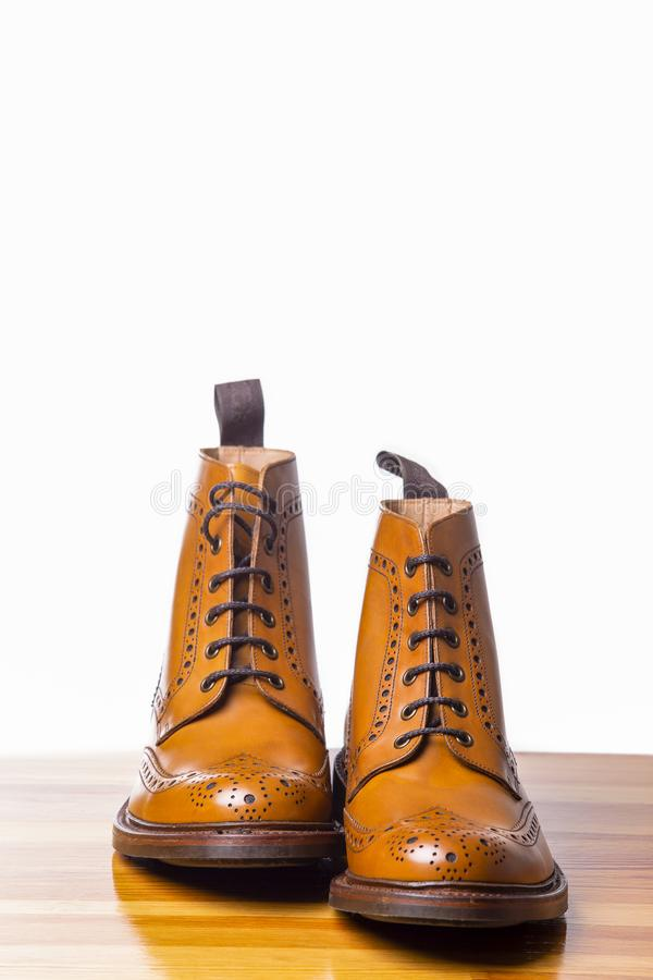 Footwear Concepts.Pair of High Gentleman Tanned Brogues Boots. Isolated Over White Background.Vertical Image royalty free stock images