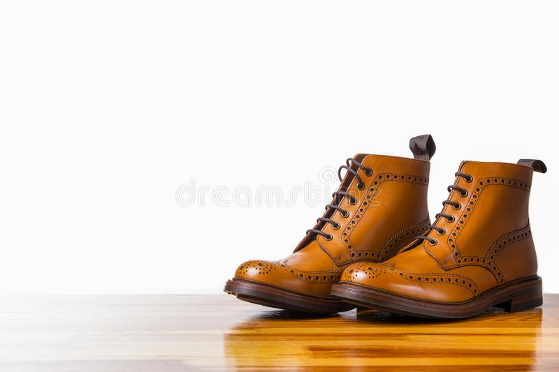 Footwear Concepts.Pair of High Gentleman Tanned Brogues Boots. Isolated Over White Background.Horizontal Image stock photography