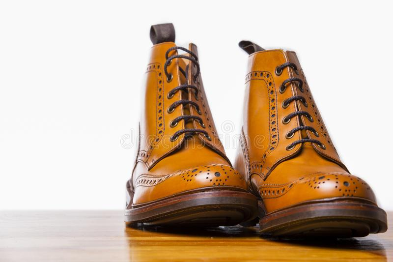 Footwear Concepts.Pair of High Gentleman Tanned Brogues Boots. I. Solated Over White Background.Horizontal Composition stock images