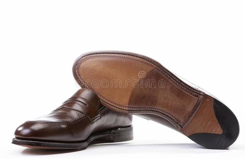 Footwear Concepts. Pair of Stylish Brown Penny Loafer Shoes royalty free stock photos