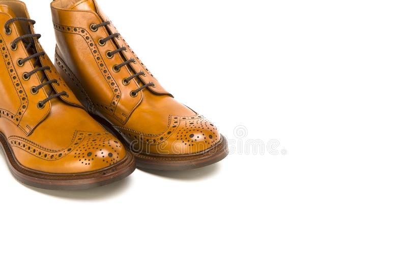 Footwear Ideas. Closeup of Pair of Premium Tanned Brogue Derby. Boots Made of Calf Leather with Rubber Sole. Isolated Over Pure White Background. Horizontal stock images