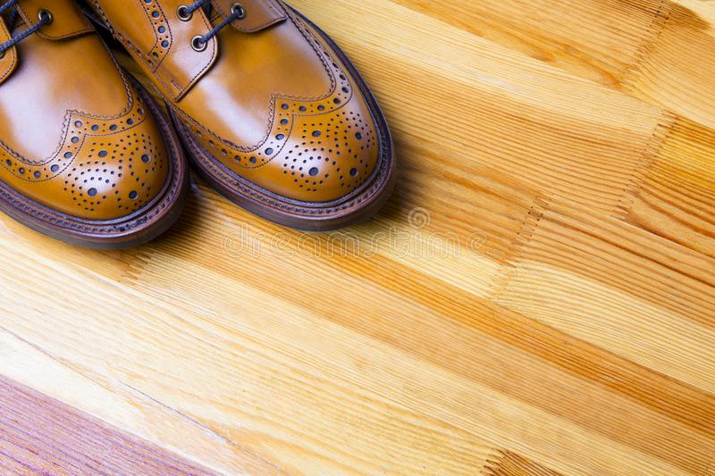 Footwear Ideas and Concepts. Closeup of Tips of Male`s Brogue Boots. Footwear Ideas and Concepts. Closeup of Tips of Male`s Brooge Boots in Tan Color. Standing royalty free stock photos
