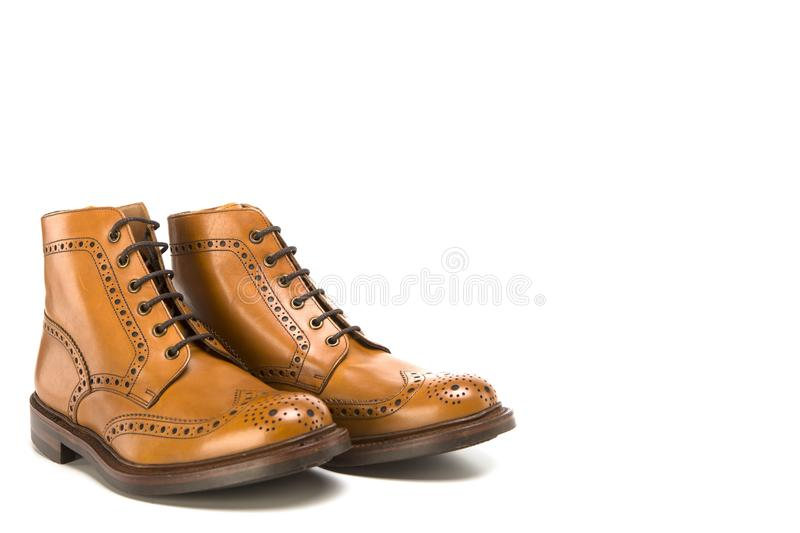 Footwear Ideas. Premium Tanned Brogue Derby Boots Made of Calf L. Eather with Rubber Sole. Isolated Over Pure White Background. Horizontal Image Orientation stock photography
