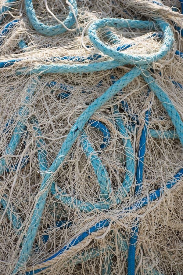 Fora da rede de pesca branca com corda azul fotografia de stock royalty free