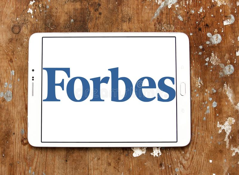 Forbes magazine logo. Logo of Forbes magazine on samsung tablet on wooden background. Forbes is an American business magazine. it features original articles on royalty free stock photo