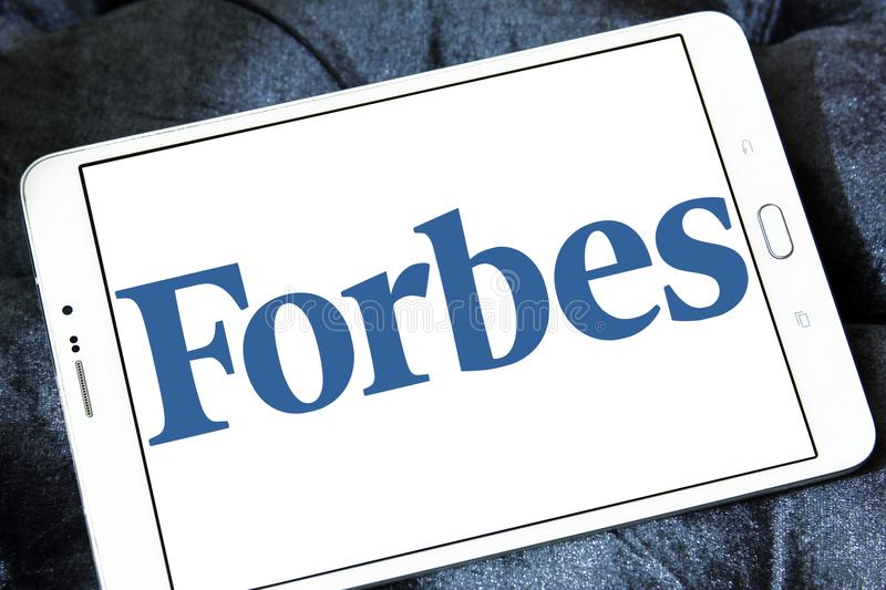 Forbes magazine logo. Logo of Forbes magazine on samsung tablet. Forbes is an American business magazine. it features original articles on finance, industry royalty free stock photo