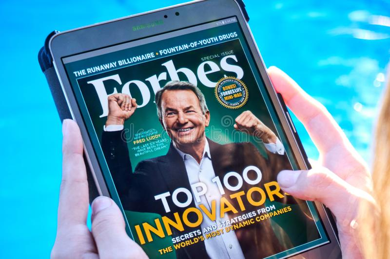 Forbes magazine on a Samsung Galaxy tablet screen. MONTREAL, CANADA - SEPTEMBER 8, 2018: Forbes magazine on a Samsung Galaxy tablet in hands royalty free stock photography